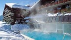 heated outdoor pool at the Spa & Wellness of the Hotel Ermitage in Schönried near Gstaad