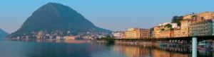 Lakeshore of Lake Lugano with the city of Lugano and Mt. Bre, Switzerland